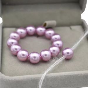 Brand new! Infant purple pearl bracelet w/tieback